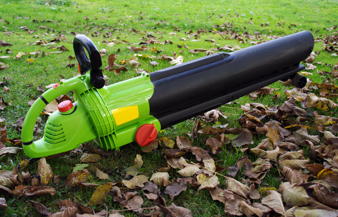 Bright green professional leaf blower equipment.